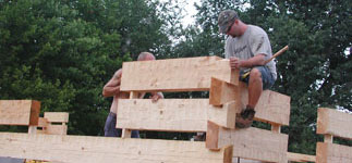 Step 2:  Erect log home exterior walls